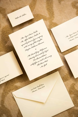 Ivory wedding stationery with black script font