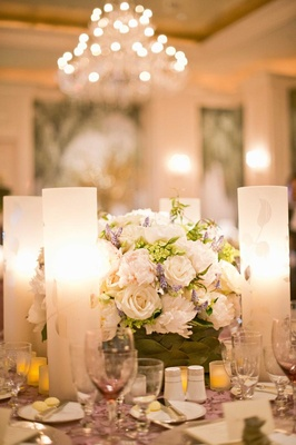 White roses and lavender next to frosted candleholder