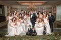 Bride in Vera Wang wedding dress, groom in tuxedo, groomsmen, bridesmaids in pink dresses