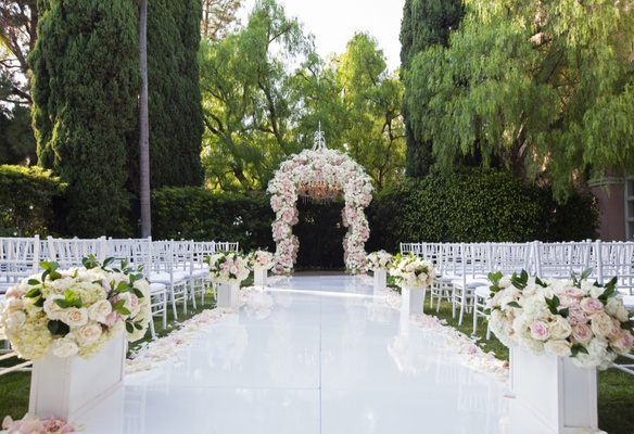 wedding ceremony white lacquer aisle pink white flowers chuppah white chairs beverly hills hotel