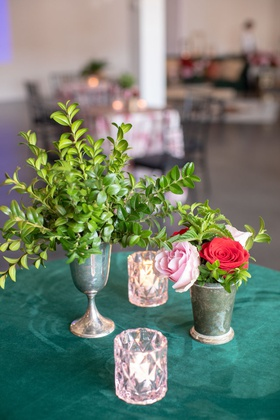 emerald linen with tin goblet of boxwood, tin cup with flowers, pale pink votive