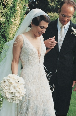 Low cut ivory lace wedding dress with feathers