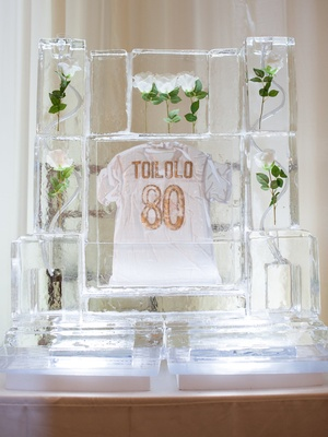 Wedding reception decor ice sculpture with white roses inside and white gold jersey Levine Toilolo
