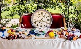 alice in wonderland inspired wedding styled shoot, clock on velvet couch, sweetheart table