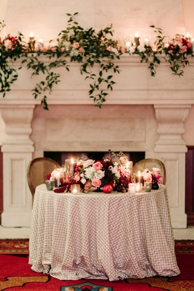 sweetheart table in front of fireplace, textured linens, fall wedding inspiration