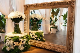 White and green flower table with white rose arrangement gold frame with wedding hashtag details