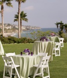 Cocktail tables on grass in front of ocean