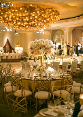 Gold lighting, gold centerpiece, blush ivory flower centerpiece, gold chairs, birch candles