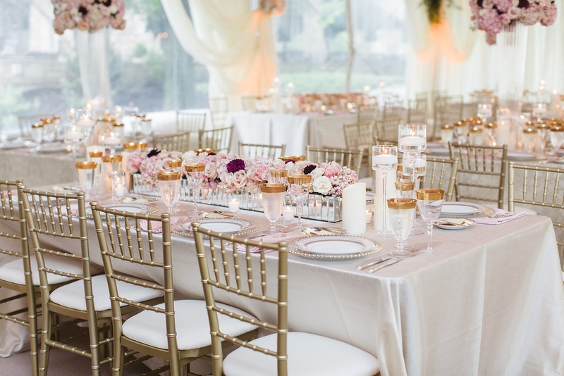 Wedding reception rectangle table linen gold chair gold glassware low centerpiece long mirror detail