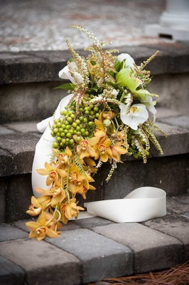 Multicolor orchid bouquet with berries and foliage