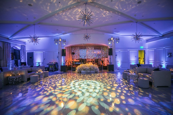 wedding after party light projections on dance floor purple lighting lounge furniture live band