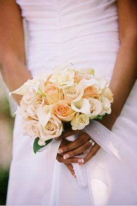 Bride's flower bouquet wrapped in silk ribbon