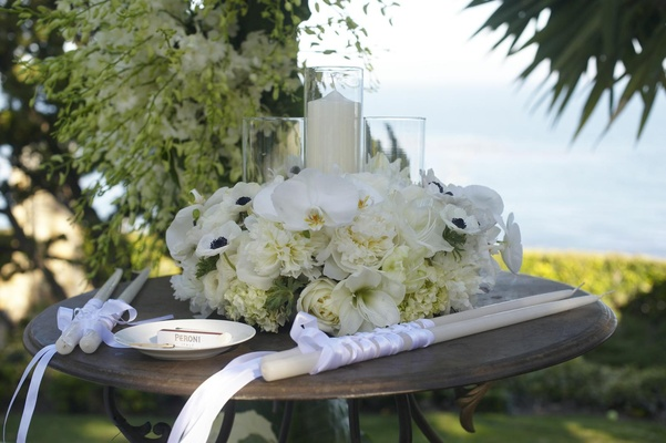Candle altar table at oceanfront wedding ceremony