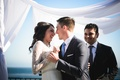 Couple enjoys first dance at oceanside reception