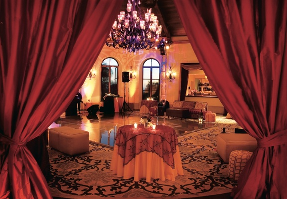 Red linens and dance floor with large chandelier