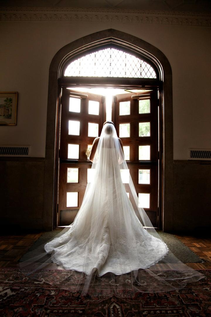 Bride in wedding dress and cathedral