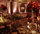 four seasons chicago wedding reception crystal and red rose centerpieces with gold linens and chairs