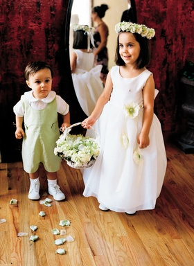 Little boy and girl dressed in white and celadon