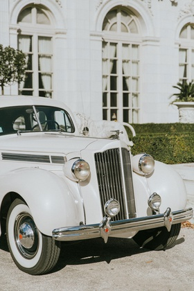 classic white wedding car in front of rosecliff mansion newport rhode island transportation