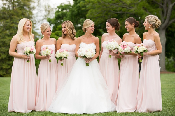 Bride with bridesmaids in strapless floor-length gowns
