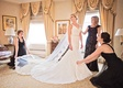 mother of the bride and bridesmaids help bride with her nelphi veil and matthew christopher gown