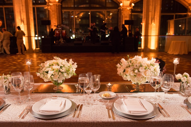 the view of the reception dance floor from the bride and grooms spot at the head table white linens