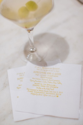 Martini on cocktail napkin with memorable moments during their courtship romance