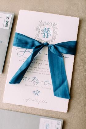 wedding invitation letterpress torn edge paper blue ribbon blue silver grey monogram script