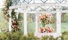 styled shoot wedding inspiration, reception table under gazebo with large two-tier centerpiece