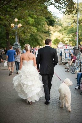 Bride and groom walk dog in Central Park