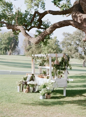 White flower cart with shabby chic decorations and herbs
