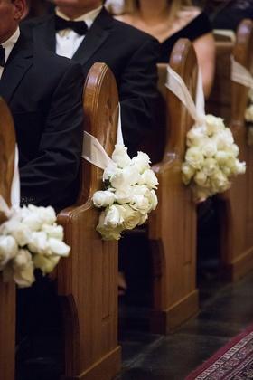 Wedding ceremony church decoration ideas white rose bundles on church pews wood white ribbon