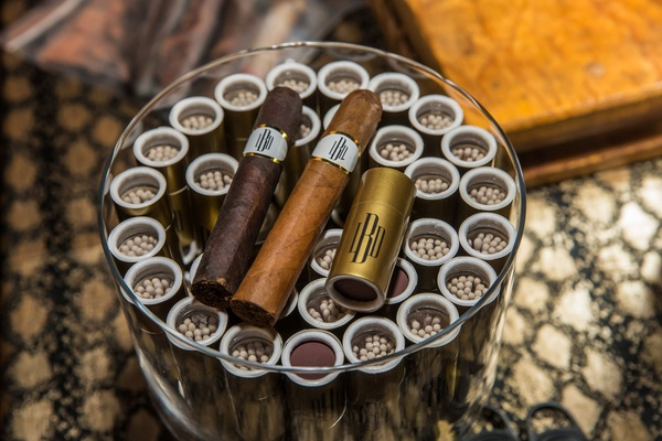 Monogram cigar and match holders at wedding cigar table wedding reception
