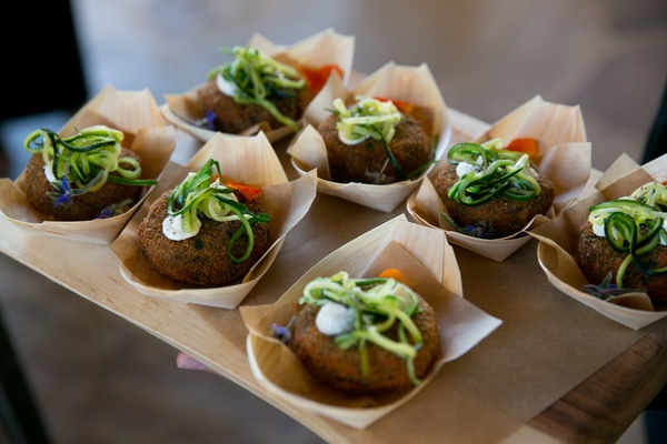 falafel with vegetable shavings on top as passed wedding appetizers