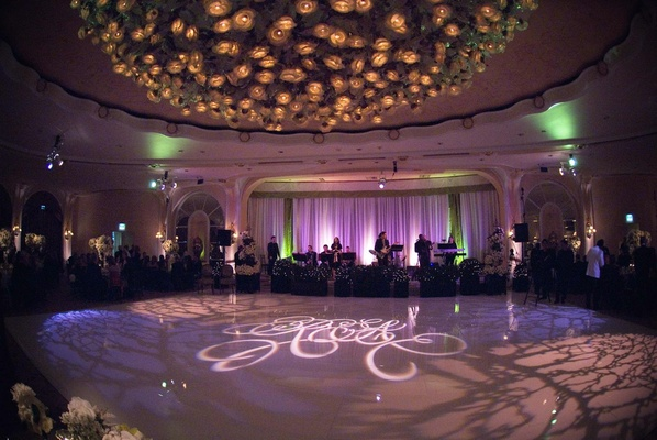 Purple lighting wedding reception with large dance floor