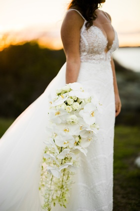 cascading bouquet white orchids other blooms roses greenery extended unique sophisticated