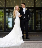 bride in galia lahav wedding dress low back half sleeves long blonde hair groom in tuxedo white tie