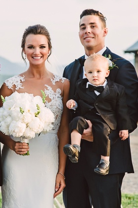 Wedding portrait bride in illusion wedding dress white peony bouquet groom with tuxedo and son