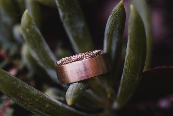 Brushed finish men's rose gold wedding ring, twisted channel set rose gold women's wedding ring