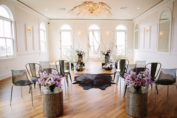 edgy alternative wedding inspiration, black ceremony chairs, cow rug for aisle runner, lavender flow
