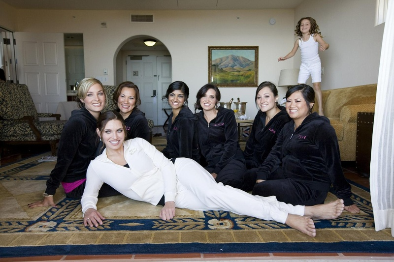 Bride in a white velour outfit with bridesmaids in black velour outfits
