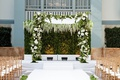 indoor ceremony chicago gold chairs white aisle greenery white flowers chuppah hedge wall boxwood