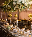 floral chandelier with tall and short candles wedding reception decor