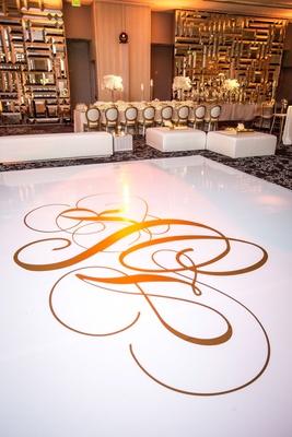 wedding white dance floor with gold monogram