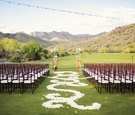 Silverleaf Club wedding ceremony with white flower petal aisle and mountains in background