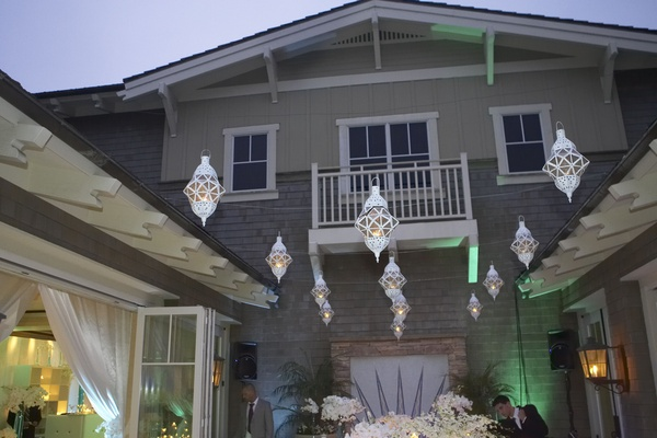 white lights hang above craftsman style building and ballroom