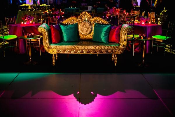 Regal loveseat next to dance floor at Indian wedding