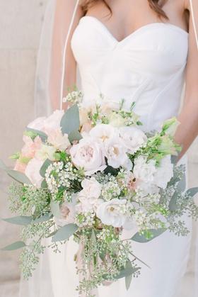 Bride in oscar de la renta strapless wedding dress greenery pink garden rose white flowers