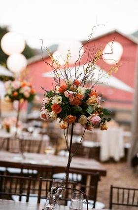 Outdoor rustic barn wedding flower centerpiece
