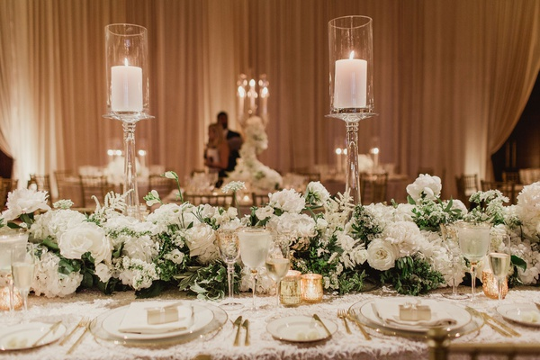 wedding reception long table texture linen clear candlestick gold candle votives flower runner